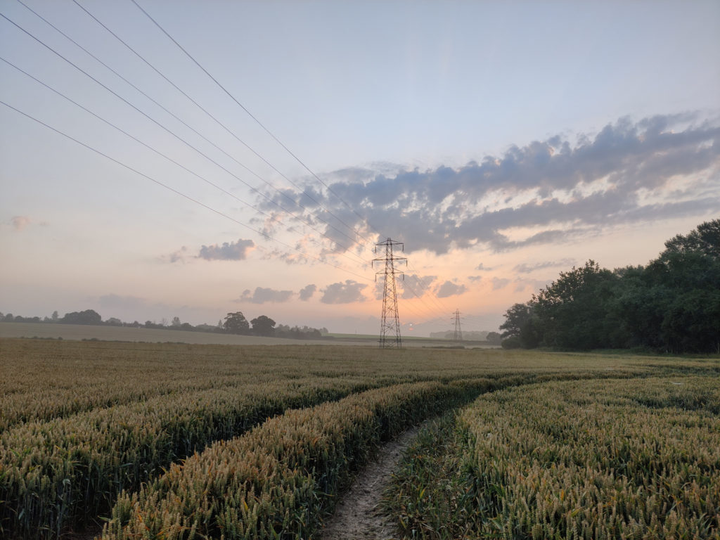 Dawn near Epping Upland, a few clouds as the sun rises over wheat fields